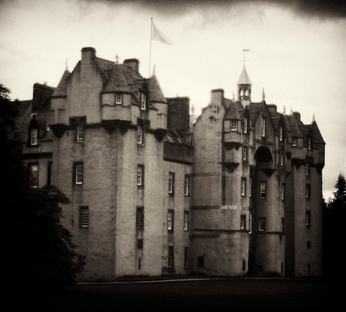The beautiful Fyvie Castle's haunted past includes a story from 1920 when, during renovation work, a skeletal woman was discovered behind a bedroom wall. On the day her remains were laid to rest in Fyvie cemetery, the castle residents started to be plagued by strange noises and unexplained occurrences. Fearing he had offended the deceased woman, this castle's Laird had the skeleton exhumed and replaced behind the bedroom wall, at which point the haunting ceased. It is said that there is a secret room in the southwestern corner that must remain sealed, lest anyone entering meet with disaster.  Fyvie castle is also said to be haunted by Lilias Drummond, or the Green Lady, as she was known who was starved to death in 1601 for being unfaithful to her husband.  The ghost of Andrew Lammie, who was a trumpeter and unsuitable suitor for the Laird's daughter, was accordingly banished, but swore the sound of his trumpet would foretell the death of every laird of Fyvie, and he kept his promise with various sights of a Lammie is full tartan attire.
