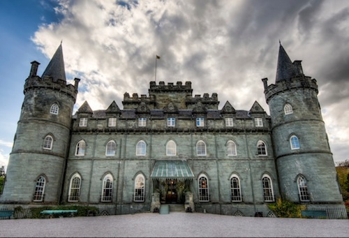 """Inveraray Castle is believed to be haunted by the ghost of a harpist who was hanged by the Duke of Montrose's men in 1644 for """"peeping at the lady of the house"""". The ghost is said to remain near the elaborately carved bed of the Lady of the House and when the bed was moved from the old Inveraray Castle to the present one, the murdered boy's ghost travelled with it.  It is said when a member of the family is about to die, the harp music is heard coming form the room.  The castle also has a grey lady, who is only seen by the daughters of a Duke of Argyll, a floating boat or 'Galley of Lorne' which floats away on the horizon on the death of the Duke."""