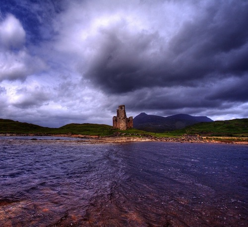 """The legend of Ardvreck says that in the 16th century the Macleod Chief dealt a deal with the Devil himself to help get the castle built by offering his daughter in marring to """"Auld Nick' - the Devil Himself.  After finding out who her groom truly was, she flung herself from the tower and her ghost is said to be heard weeping bitterly there to this day.  It is now a ruined castle which stands on a rocky promontory jutting out into Loch Assynt in Sutherland in the north west of Scotland."""
