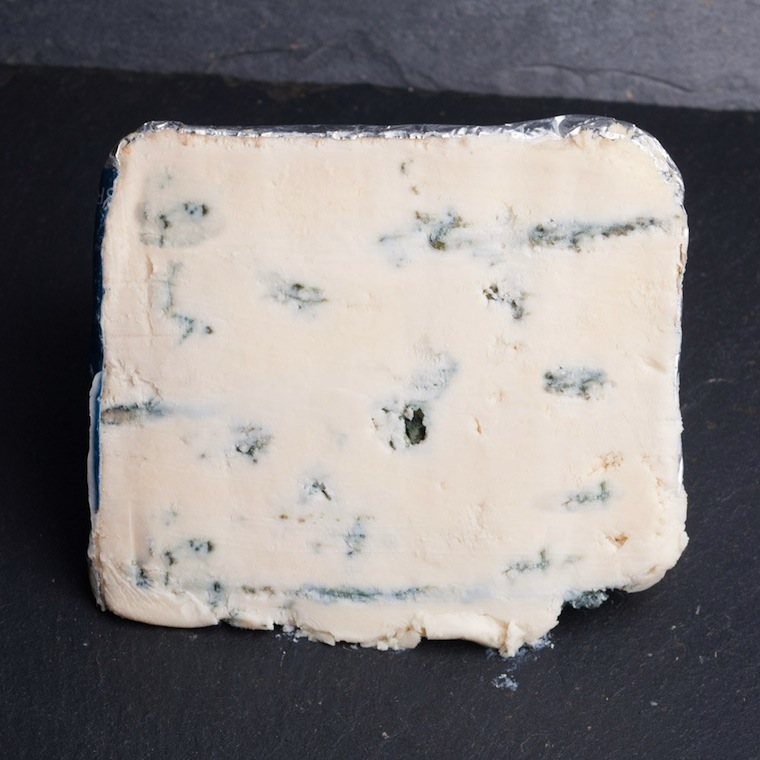 This is a beautifully crafted Goat's milk blue. The cheese is named after the close-by Borders town, which displays a goat as part of its emblem. The cheese is still young, but ready to be served. Lactic and clean in taste with a mild aroma of fresh goats milk. The spicy tang of the blue veining works well to give it plenty of character.  Biggar Blue is made by Selina Cairn who is the daughter of the Lanark Blue Cheese's creator Humphrey Errington.  Biggar blue is unpasteurised and suitable for vegetarians.