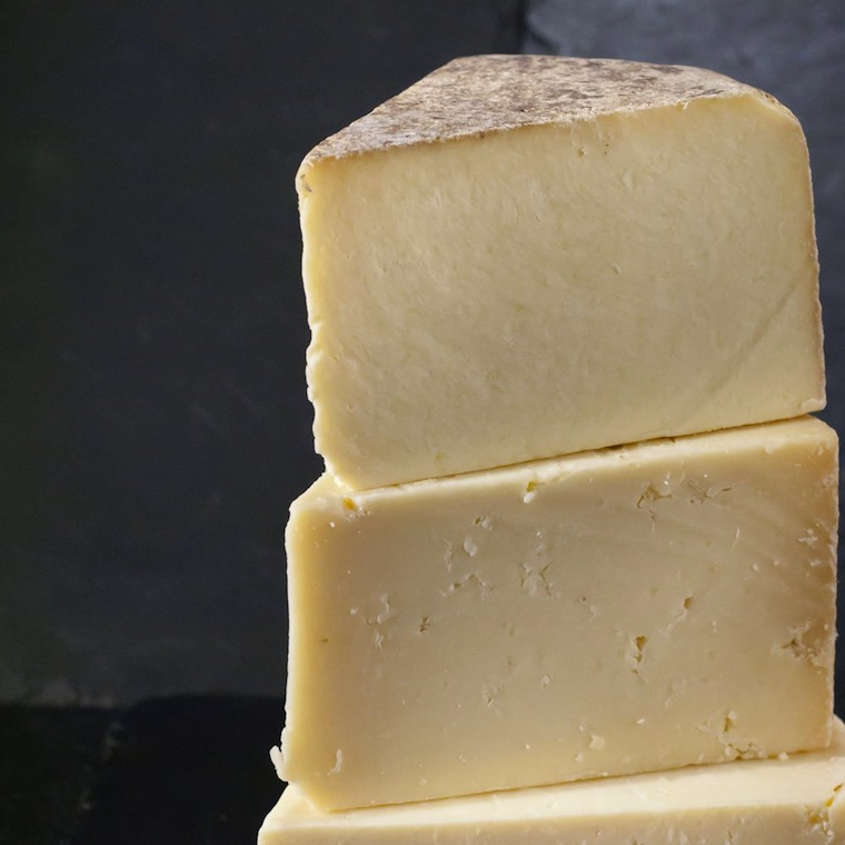 A unique hand made cheese, recreated as it was. This hand pressed 2 day curd melts in your mouth and has a finish that leaves you dreaming of days gone by. Strong and creamy, this flagship cheese is nutty and flavoursome. The first authentic reproduction of this cheese since the 1970's based on Barbara Reid's traditional farmhouse recipe.